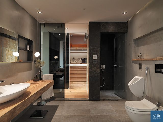 淋浴區貼了比水泥粉光、霧面石英磚更深的灰黑色瓷磚